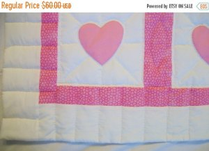 https://www.etsy.com/listing/256204311/baby-quilt-pink-and-white-appliqued-with?ref=teams_post